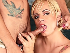 Pig-tailed blonde tranny Thays Schiavinato joins her man as he suns himself poolside. He helps her off with her panties and bends her over to lick and finger her tight asshole, and she sits to suck his hard cock. He does the same, sucking her dick while her jerks himself off. She gets on her hands and knees to take it up her tight asshole doggy style, and she climbs on top to ride him reverse anal cowgirl. He bends over to also have his butt hole reamed, and she gives him a facial before he blows his load all over her tits.